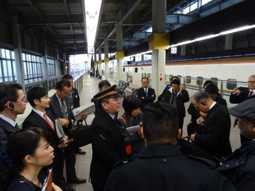 Kanazawa station master giving a briefing
