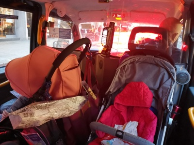 Two strollers in London cab